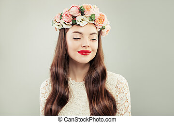 Pretty Model Looking Aside. Beautiful Woman with Long Hair, Make up and Flowers. Spring Beauty Girl