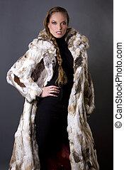 fur coat - pretty model wearing fur coat and black pants...