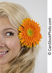 pretty model with flower in her hair