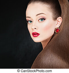 Pretty Model Woman with Long Healthy Smooth Brown Hair and Makeup. Perfect Ponytail Hairstyle. Beautiful Girl on Dark Background