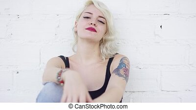 Pretty modern young woman with a tattoo