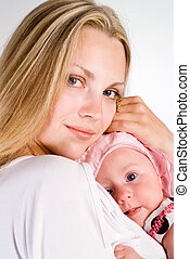 pretty mom with baby - portrait of a mom with her baby