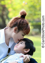 pretty mommy kissing her cute son