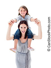 Pretty mother giving her daughter piggyback ride