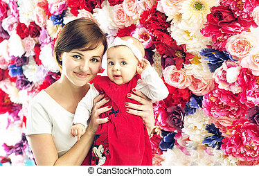 Pretty mother with smling, cute baby