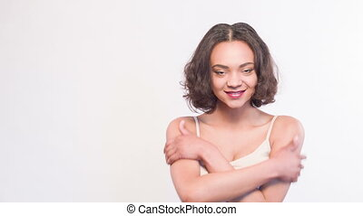 Pretty mulatto girl with welcoming embrace