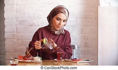 Pretty muslim girl in hijab in cafe. - Pretty muslim girl in...