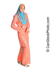 Pretty muslim woman model in catwalk action, on white...