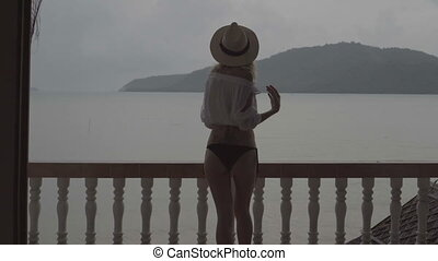 Pretty natural woman on summer day. - Back view of pretty...