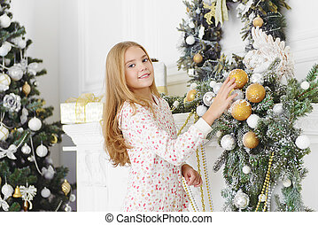 nine year old girl - Pretty nine year old girl decorates the...