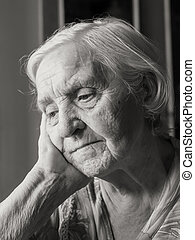 old grandmother - Pretty old grandmother sitting alone ...