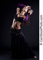 Pretty oriental dancer with long hair