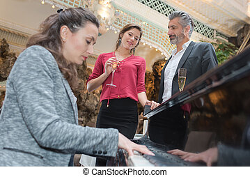 pretty pianist playing for clients in a restaurant