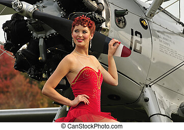 pretty pinup with a vintage plane