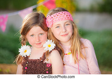 sisters - pretty portrait of happy children kids or sisters