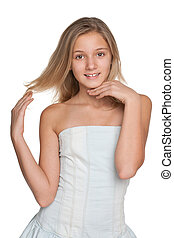 Pretty preteen girl against the white