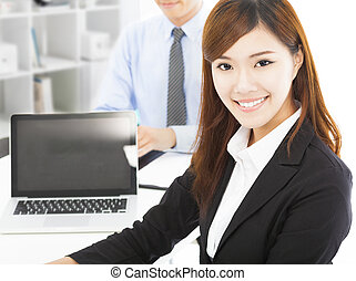 pretty professional young woman with colleague in office