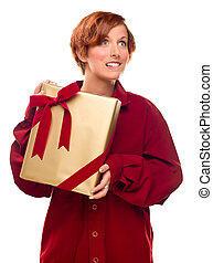 Pretty Red Haired Girl Biting Lip Holding Wrapped Gift