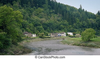 Pretty Rural Scene With Houses By The River