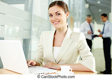 Pretty secretary - A beautiful businesswoman looking at ...
