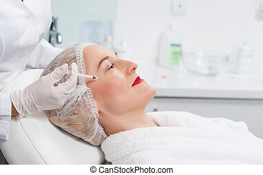 Pretty senior lady is visiting beauty surgeon