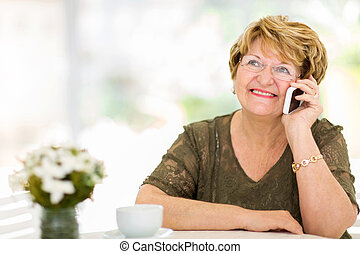 senior woman talking on her cell phone - pretty senior woman...
