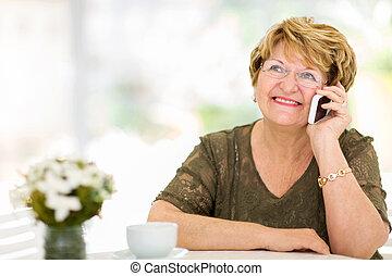 senior woman talking on her cell phone - pretty senior woman...