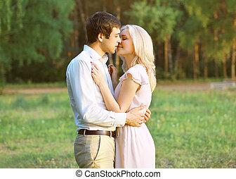 Pretty sensual couple in love outdoors