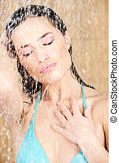 Pretty sensual woman having a shower