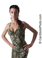 Pretty sensual woman posing in fashion dress