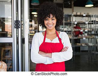 Pretty server in red apron