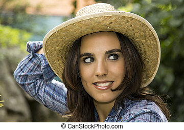Pretty sexy woman face with a straw hat