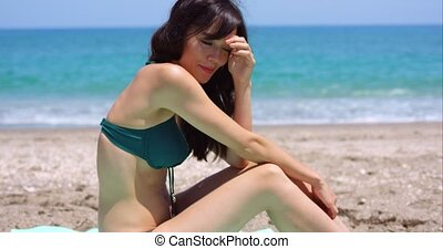 Pretty sexy young woman sunbathing