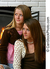 Pretty Sisters by Fireplace