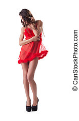 Pretty slender woman posing in red erotic negligee