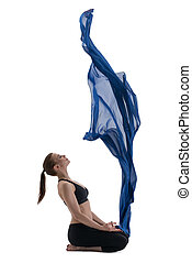 Pretty slim girl looks at blue flying up cloth