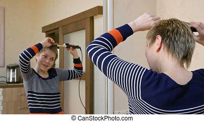 Pretty smiley blond short hair woman curls hair