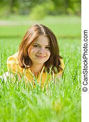 brunette girl relaxing in grass