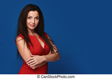 pretty smiling brunette woman in red dress.