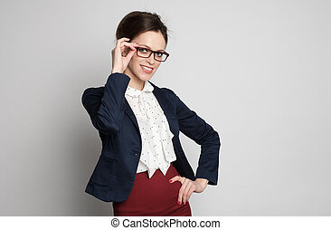 pretty smiling business woman wearing glasses