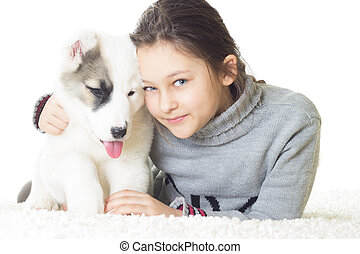 Pretty smiling girl and puppy