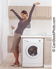pretty smiling girl in the laundry room lhk