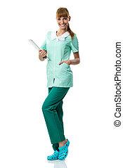 Pretty smiling nurse holding a folder