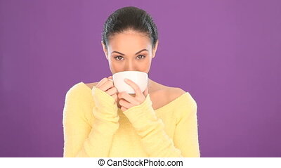 Pretty smiling woman drinking tea