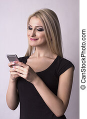 Pretty smiling woman holding mobile phone