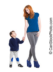 Pretty smiling woman posing with a little boy