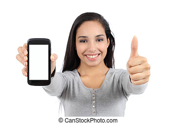 Pretty smiling woman showing a blank vertical smart phone screen and thumb up isolated