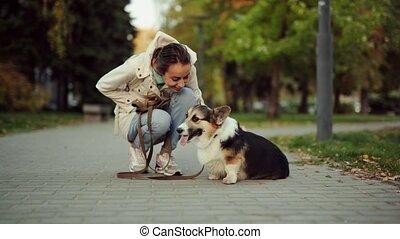 Pretty smiling Woman Walking Cute Dog In Nature - pretty ...