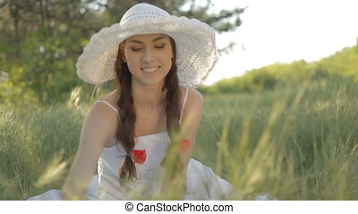 Pretty smiling young woman sitting