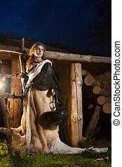 Pretty sorceress with the magic cauldron
